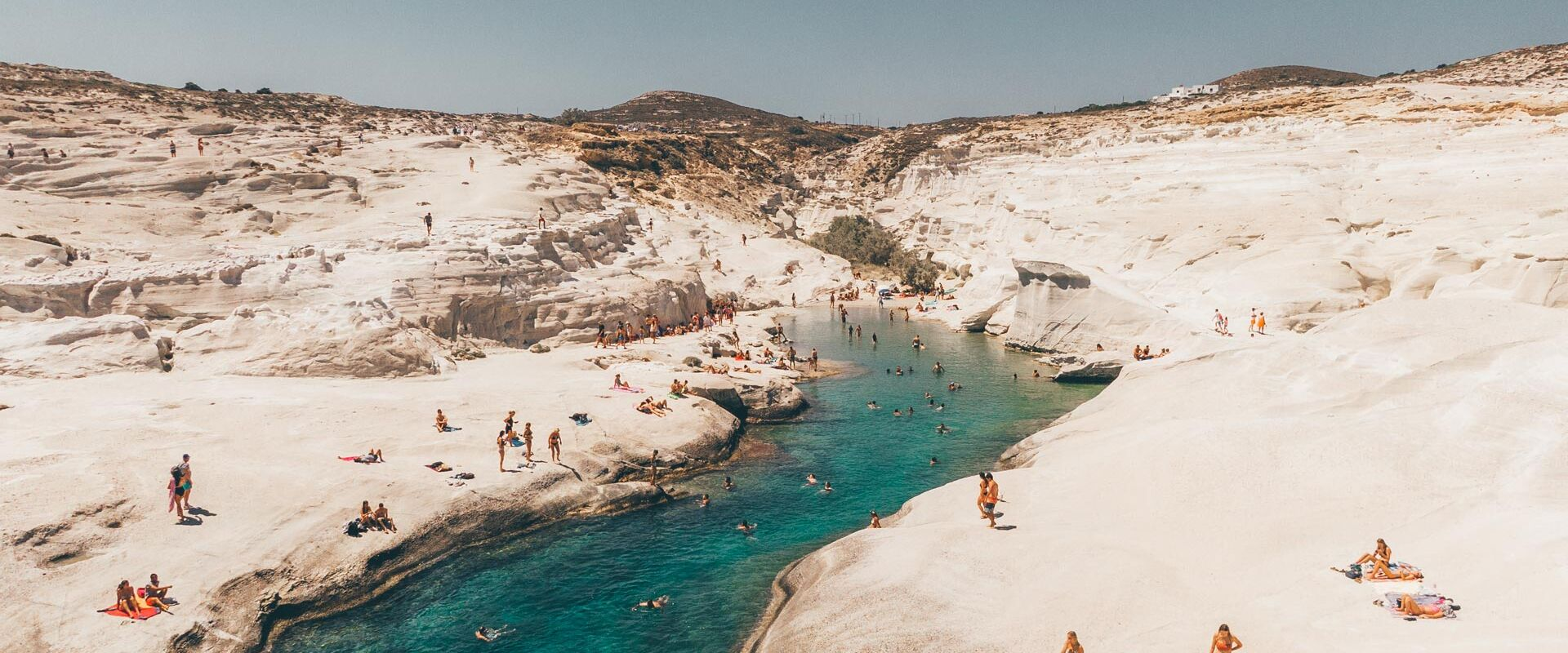 In Sarakiniko, you can literally spend a whole day lazing on the rocks