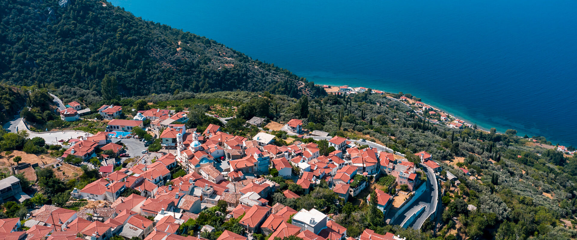 Birds eye view of Ampelos village with great view of Aegean