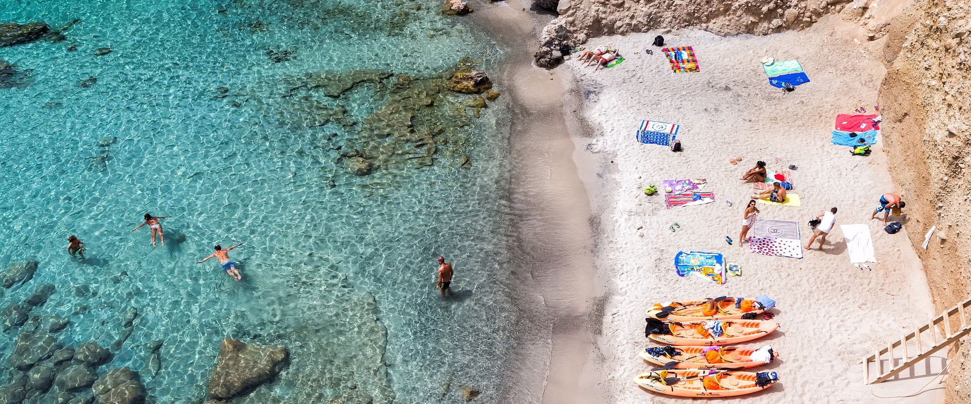 Milos, Greece - September 10, 2015: Top view of canoes at Tsigrado Beach in Milos island, Cyclades,