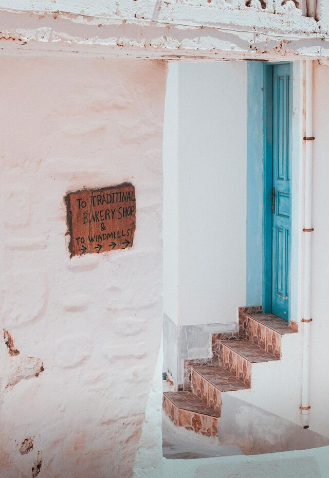 White and pastel-washed buildings of Olympos
