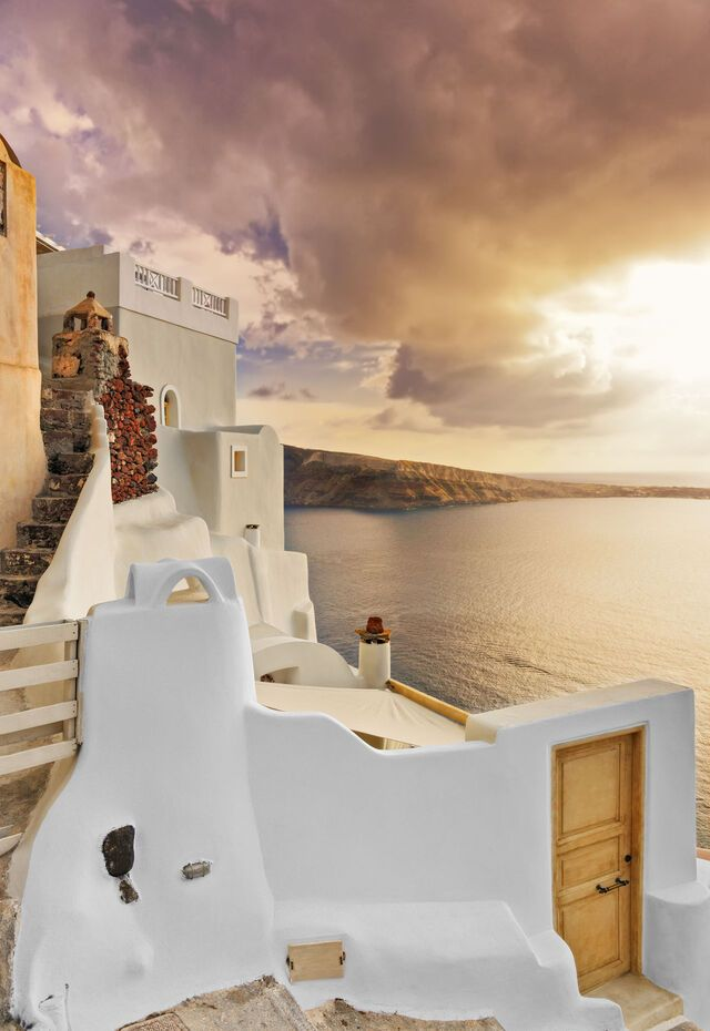Typical villa overlooking the caldera at dusk in Oia, Santorini, Cyclades, Greece