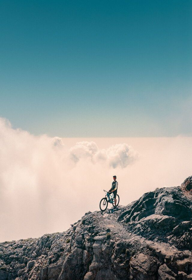 Mountain-biking towards the clouds at Mt Olympus