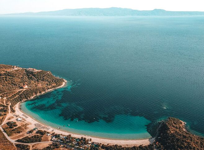 Alikes, one of most beautiful and popular beaches on the island, looking onto the Sithonia peninsula