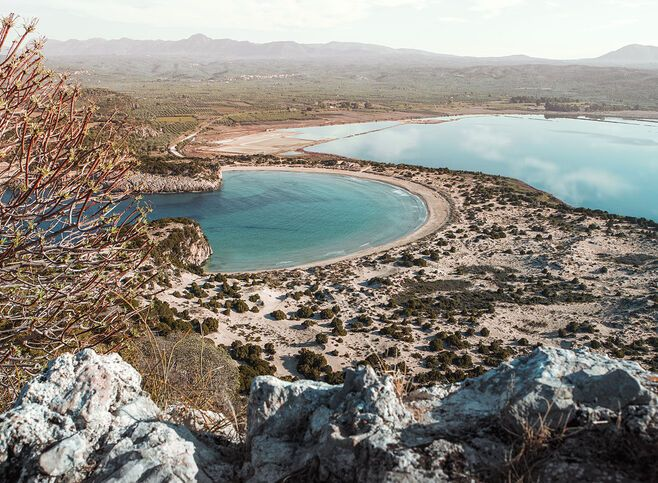 Voidokilia, the majesty of nature quite like the iconic horseshoe-shaped beach and its accompanying saltwater lagoon in Messinia