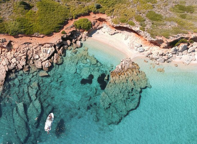 The southern part of the island is embroidered with beaches, charming bays and green-blue water