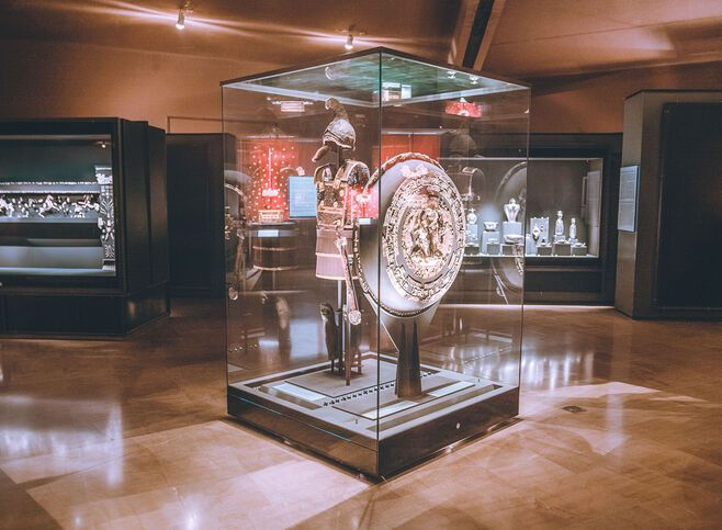 The immense armour of King Philip II, displayed in evocatively dimmed light