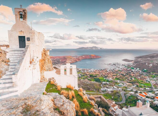 From the beautiful chapel of Agios Konstantinos nearby, you can look out beyond Livadi onto a who's who of Cycladic islands