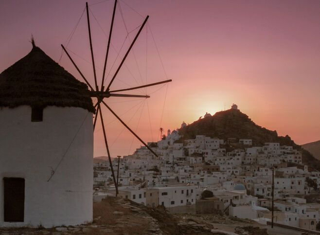Walking around Hora, you'll discover a labyrinth of whitewashed alleyways and photogenic windmills