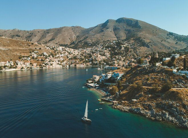 Arriving at Gialos, Symi's main port imprints itself into your memory like a photograph.