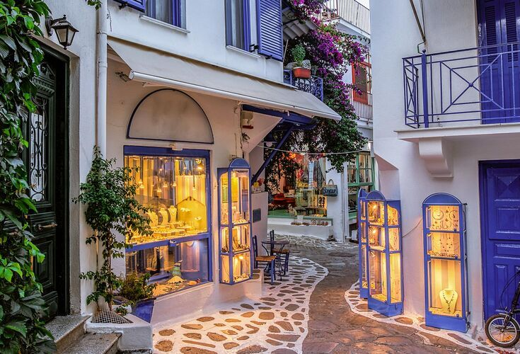 Town of Skiathos with whitewashed houses and red tiled roofs between the narrow streets
