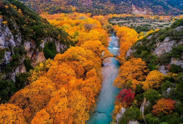 Aerial view of the Old stone bridge in Klidonia Zagoria in the autumn, Epirus, Western Greece. This arch bridge with elongated arch built in 1853.