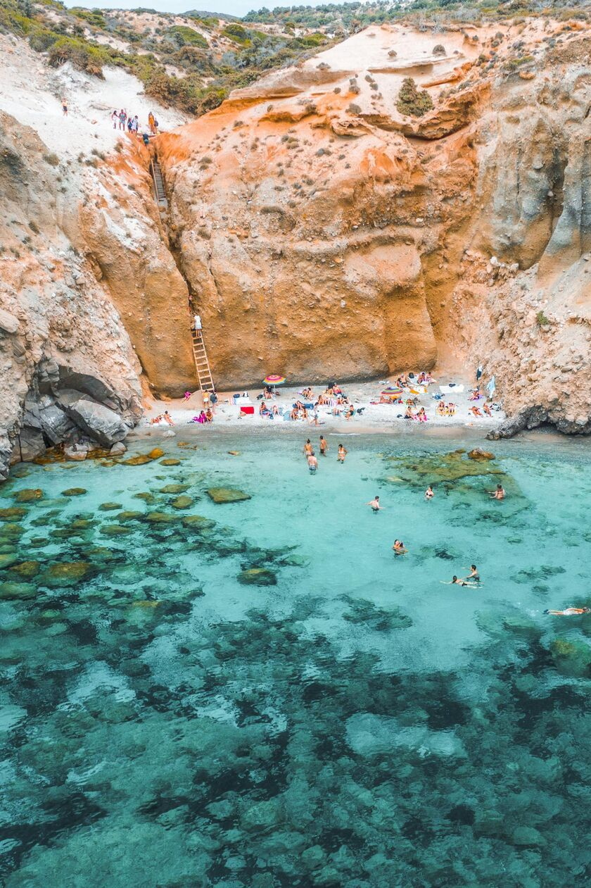 Nestled beneath vertical cliffs, this small beach offers wonderful isolation and beautiful swimming